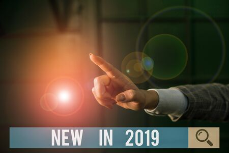 Conceptual hand writing showing New In 2019. Concept meaning what will be expecting or new creation for the year 2019 Finger pointing in the Dark with hand pointing in the copy space