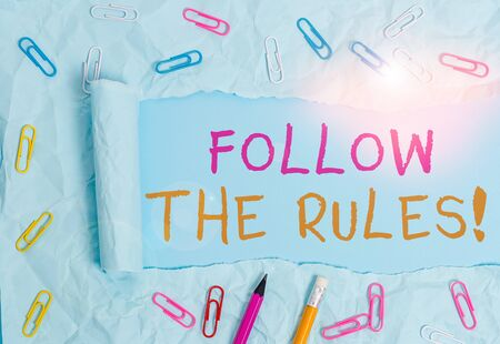 Conceptual hand writing showing Follow The Rules. Concept meaning go with regulations governing conduct or procedure Stationary and torn cardboard on a plain pastel table backdrop Stock fotó - 133421273