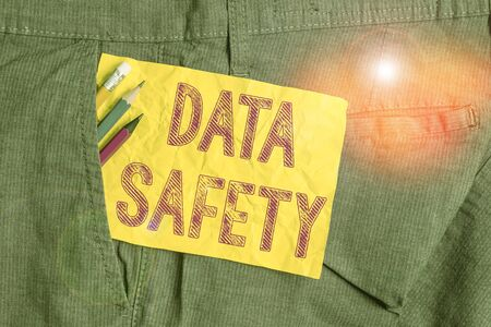 Word writing text Data Safety. Business photo showcasing concerns protecting data against loss by ensuring safe storage Writing equipment and yellow note paper inside pocket of man work trousers Stock Photo