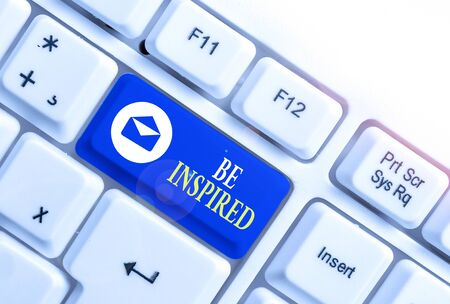 Word writing text Be Inspired. Business photo showcasing give oneself the desire or enthusiasm to do something well White pc keyboard with empty note paper above white background key copy space