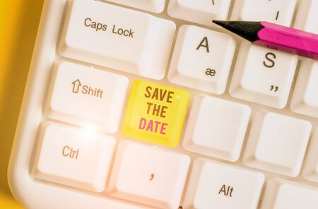 Conceptual hand writing showing Save The Date question. Concept meaning asking someone to remember specific day or time White pc keyboard with note paper above the white background Stok Fotoğraf - 133423222