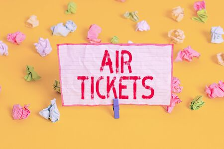 Conceptual hand writing showing Air Tickets. Concept meaning individual is entitled to a seat on a flight on an aircraft Colored crumpled paper empty reminder white floor clothespin Stockfoto