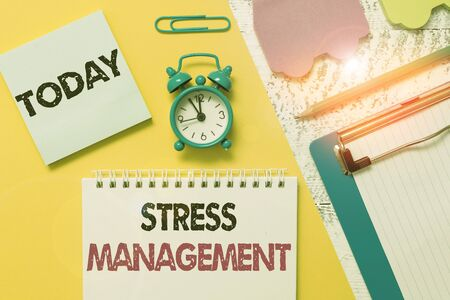 Word writing text Stress Management. Business photo showcasing method of limiting stress and its effects by learning ways Notepad clipboard clip sheet marker car sticks alarm clock wood background