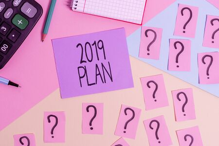Conceptual hand writing showing 2019 Plan. Concept meaning setting up your goals and plans for the current year or in 2019 Mathematics stuff and writing equipment on pastel background Stock fotó