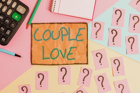 Writing note showing Couple Love. Business concept for two showing who love each other very much Feeling pleasure Mathematics stuff and writing equipment above pastel colours background
