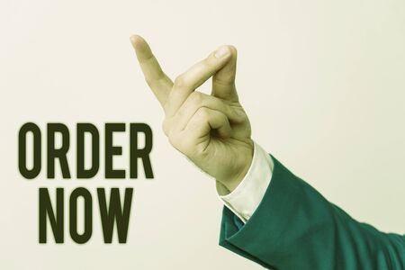 Handwriting text Order Now. Conceptual photo the activity of asking for goods or services from a company Isolated hand pointing with finger. Business concept pointing finger Reklamní fotografie