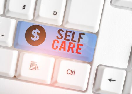 Writing note showing Self Care. Business concept for the practice of taking action to improve one s is own health White pc keyboard with note paper above the white background