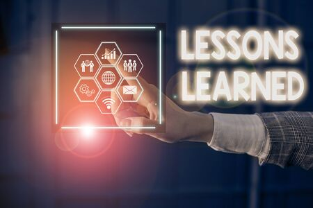 Writing note showing Lessons Learned. Business concept for the knowledge or understanding gained by experience Picture photo network scheme with modern smart device Stockfoto