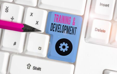 Word writing text Training And Development. Business photo showcasing learn specific knowledge to improve perforanalysisce White pc keyboard with empty note paper above white background key copy space