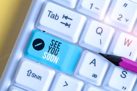 Text sign showing See You Soon. Business photo text used for saying goodbye to someone and going to meet again soon White pc keyboard with empty note paper above white background key copy space Stockfoto