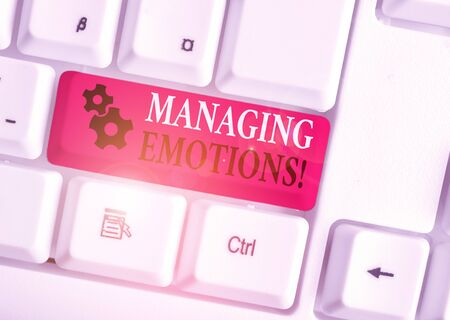 Conceptual hand writing showing Managing Emotions. Concept meaning ability be open to feelings and modulate them in oneself White pc keyboard with note paper above the white background