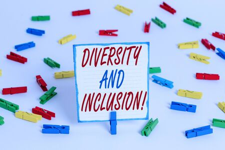 Handwriting text Diversity And Inclusion. Conceptual photo range huanalysis difference includes race ethnicity gender Colored clothespin papers empty reminder white floor background office Stockfoto