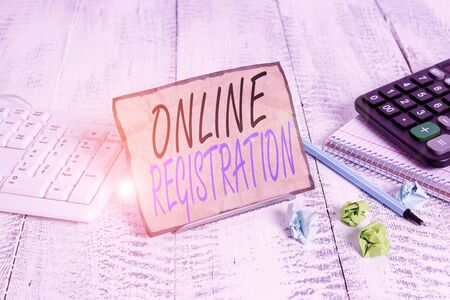 Writing note showing Online Registration. Business concept for System for subscribing or registering via the Internet Notepaper on wire in between computer keyboard and sheets