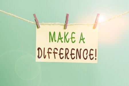 Word writing text Make A Difference. Business photo showcasing have significant effect or non on demonstrating or situation Clothesline clothespin rectangle shaped paper reminder white wood desk Stockfoto