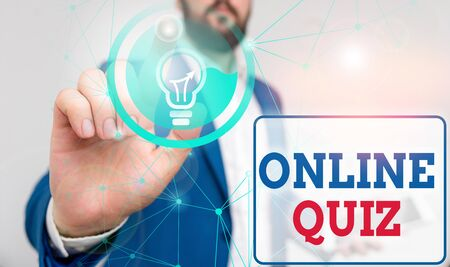 Writing note showing Online Quiz. Business concept for game or a mind sport that are published on the Internet Male human wear formal suit presenting using smart device Stockfoto