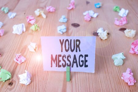 Writing note showing Your Message. Business concept for piece of information or a request that you send to someone Colored crumpled papers wooden floor background clothespin Banco de Imagens