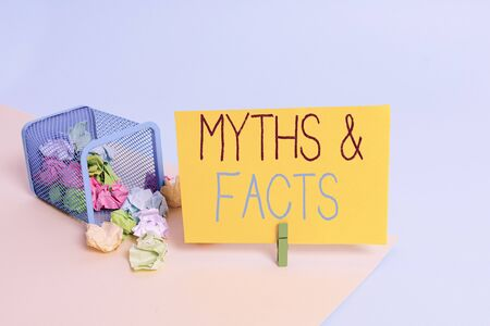 Handwriting text Myths And Facts. Conceptual photo usually traditional story of ostensibly historical events Trash bin crumpled paper clothespin empty reminder office supplies tipped 版權商用圖片