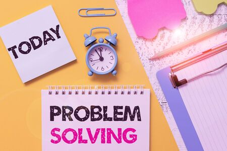 Word writing text Problem Solving. Business photo showcasing process of finding solutions to difficult or complex issues Notepad clipboard clip sheet marker car sticks alarm clock wood background