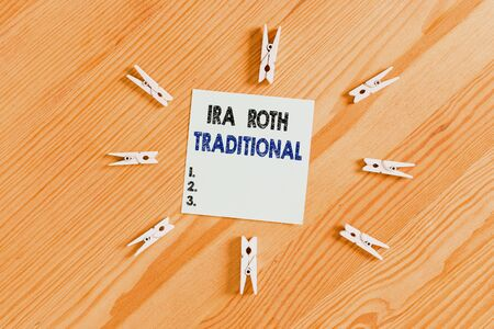 Word writing text Ira Roth Traditional. Business photo showcasing are tax deductible on both state and federal Colored clothespin papers empty reminder wooden floor background office Stock Photo