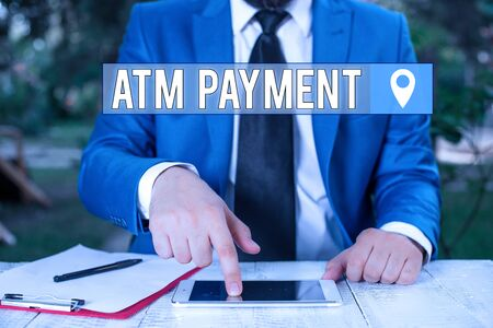 Writing note showing Atm Payment. Business concept for Cashless Payment made through portable electronic devices Businessman with pointing finger in front of him Stock fotó