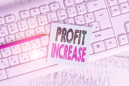 Writing note showing Profit Increase. Business concept for the growth in the amount of revenue gained from a business Keyboard office supplies rectangle shape paper reminder wood