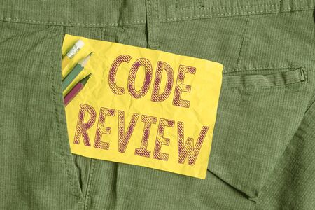 Word writing text Code Review. Business photo showcasing single most effective technique for identifying security flaws Writing equipment and yellow note paper inside pocket of man work trousers