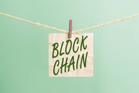Text sign showing Block Chain. Business photo showcasing system in which a record of transactions made in bitcoin Clothesline clothespin rectangle shaped paper reminder white wood desk