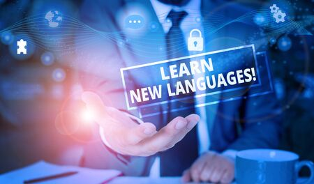 Handwriting text Learn New Languages. Conceptual photo developing ability to communicate in foreign lang Picture photo system network scheme modern technology smart device