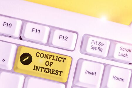 Conceptual hand writing showing Conflict Of Interest. Concept meaning disagreeing with someone about goals or targets White pc keyboard with note paper above the white background Stok Fotoğraf