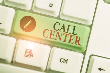 Handwriting text writing Call Center. Conceptual photo an office in which large numbers of telephone calls are handled White pc keyboard with empty note paper above white background key copy space