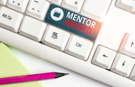Writing note showing Mentor Needed. Business concept for wanted help for more experienced or more knowledgeable demonstrating White pc keyboard with note paper above the white background Standard-Bild - 133484616