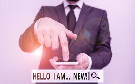 Text sign showing Hello I Am New. Business photo text introducing oneself in a group as fresh worker or student Male human wear formal work suit hold smart hi tech smartphone use one hand