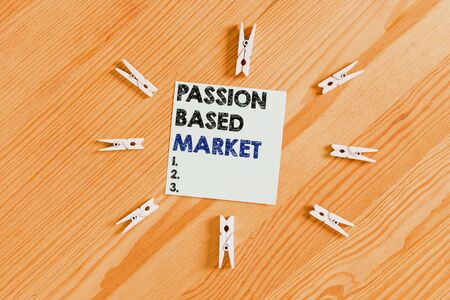 Word writing text Passion Based Market. Business photo showcasing Emotional Sales Channel a Personalize centric Strategy Colored clothespin papers empty reminder wooden floor background office