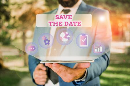 Writing note showing Save The Date question. Business concept for asking someone to remember specific day or time Male human wear formal suit presenting using smart device Фото со стока
