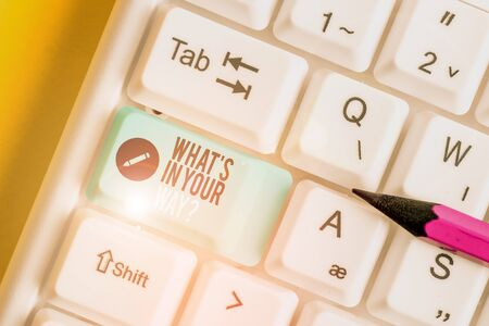 Text sign showing What S Is In Your Way question. Business photo text someone needs for a particular action White pc keyboard with empty note paper above white background key copy space Standard-Bild - 133485204