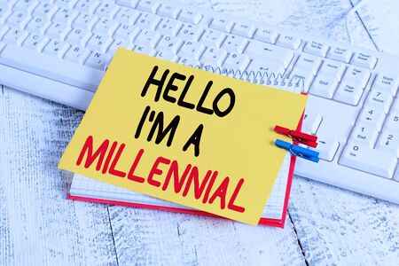 Text sign showing Hello I M A Millennial. Business photo showcasing demonstrating reaching young adulthood in current century notebook paper reminder clothespin pinned sheet white keyboard light wooden