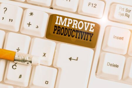 Text sign showing Improve Productivity. Business photo text to increase the machine and process efficiency White pc keyboard with empty note paper above white background key copy space Reklamní fotografie