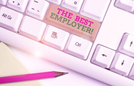 Text sign showing The Best Employer. Business photo showcasing created workplace showing feel heard and empowered White pc keyboard with empty note paper above white background key copy space Stok Fotoğraf