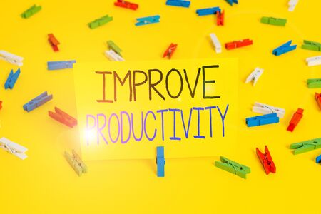 Text sign showing Improve Productivity. Business photo text to increase the machine and process efficiency Colored clothespin papers empty reminder yellow floor background office
