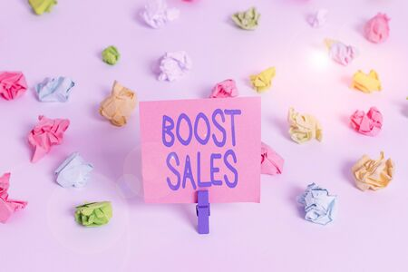 Writing note showing Boost Sales. Business concept for move sales profit from a lower to a higher place or position Colored crumpled paper empty reminder white floor clothespin Reklamní fotografie