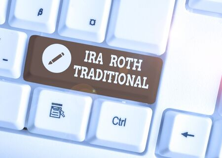 Text sign showing Ira Roth Traditional. Business photo showcasing are tax deductible on both state and federal White pc keyboard with empty note paper above white background key copy space Stock Photo