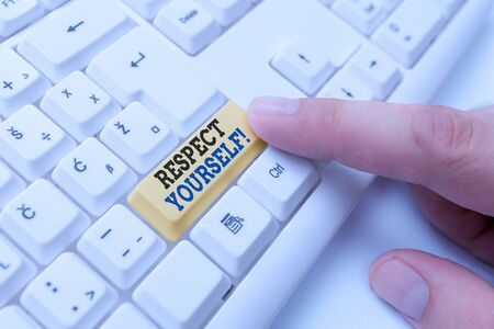 Conceptual hand writing showing Respect Yourself. Concept meaning believing that you good and worthy being treated well White pc keyboard with note paper above the white background