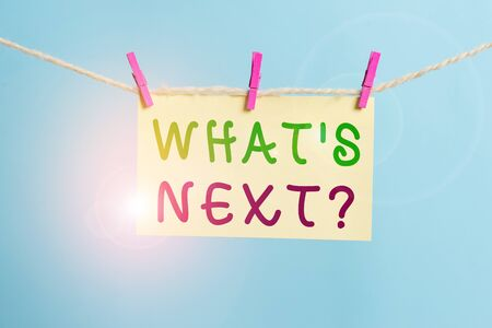 Word writing text What S Next Question. Business photo showcasing asking demonstrating about his coming actions or behaviors Clothesline clothespin rectangle shaped paper reminder white wood desk Standard-Bild - 133486243