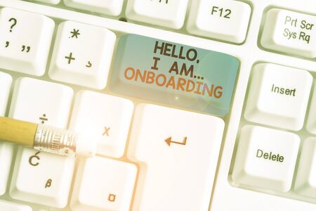 Writing note showing Hello I Am Onboarding. Business concept for telling demonstrating that you are on ship or plane White pc keyboard with note paper above the white background