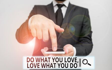 Text sign showing Do What You Love Love What You Do. Business photo text you able doing stuff you enjoy it to work in better places then Male human wear formal work suit hold smart hi tech smartphone use one hand