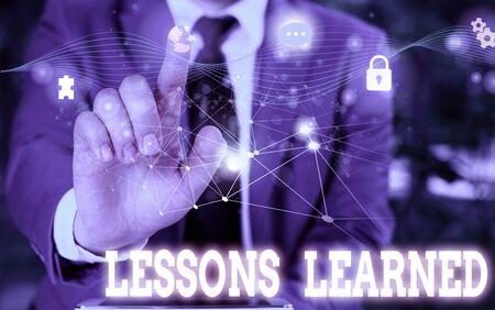 Writing note showing Lessons Learned. Business concept for the knowledge or understanding gained by experience Picture photo network scheme with modern smart device 스톡 콘텐츠
