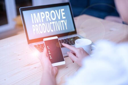 Text sign showing Improve Productivity. Business photo text to increase the machine and process efficiency woman laptop computer smartphone mug office supplies technological devices Reklamní fotografie