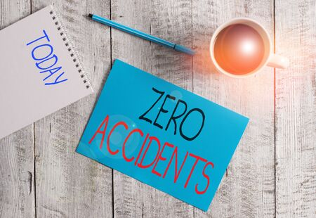 Writing note showing Zero Accidents. Business concept for important strategy for preventing workplace accidents Stationary placed next to a cup of black coffee above the wooden table Archivio Fotografico - 133486652