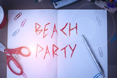 Text sign showing Beach Party. Business photo text large group of showing are organizing an event at the beach Scissors and writing equipments plus math book above textured backdrop