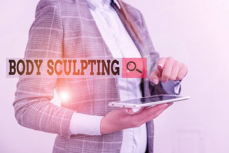 Text sign showing Body Sculpting. Business photo showcasing activity of increasing the body s is visible muscle tone Business concept with mobile phone and business woman Standard-Bild - 134437819